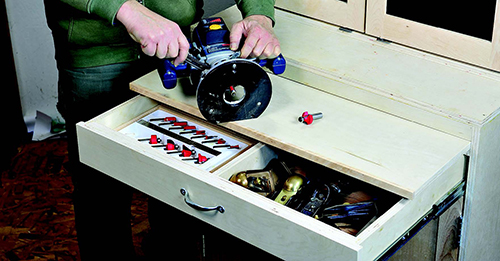Tool storage cabinet with open drawer and workshelf
