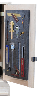 Tools pressed into kaizen foam block and stored in tool cabinet