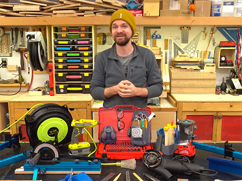 Michael Alm displaying his favorite new woodworking tools