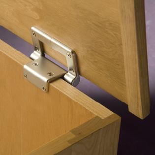Close-up of a torsion stay hinge on a desk