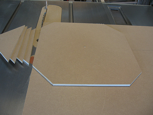 Start a circle cut on a table saw by taking off the panel's corners