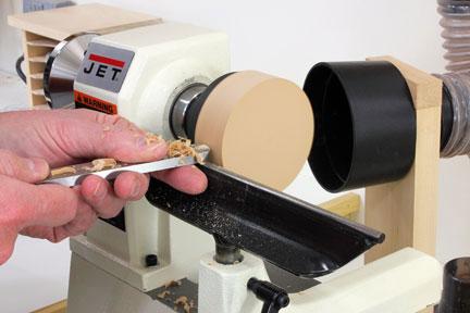 Turning glue block on lathe to true it