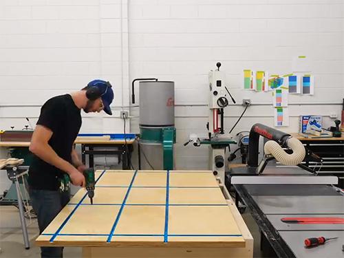 Chris Salomone adding t-tracks to a workbench tabletop