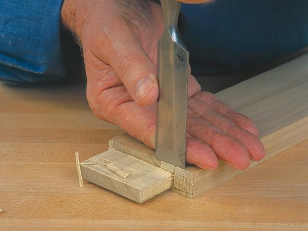Bench chisel making a cut on a tenon