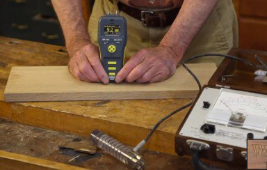 Checking moisture content of wood with a moisture meter