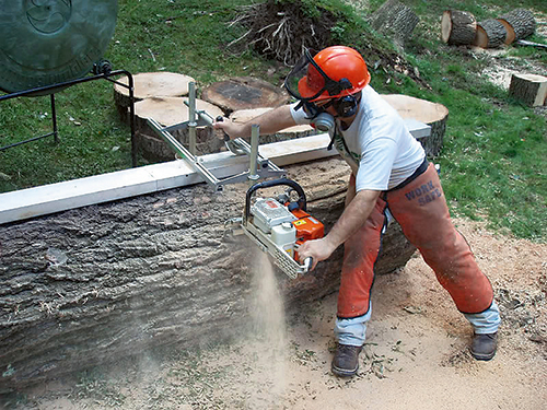 Using chainsaw and rail to cut lumber from a log