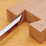 Cutting an angled joint with a beveled chisel