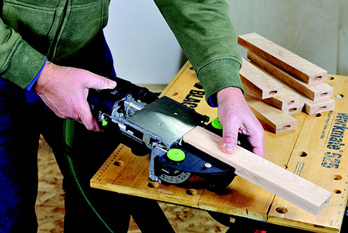 Festool Domino tool cutting slots for rail joinery