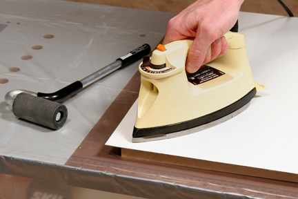 Heating and smoothing laminate adhesive with an iron