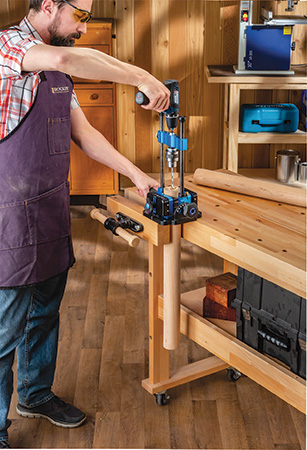 Rockler drilling guide in use on a workbench