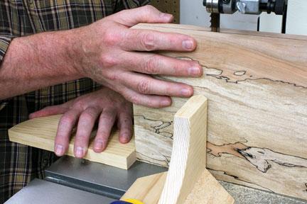 Pushing book-match panel cut with sacrificial block