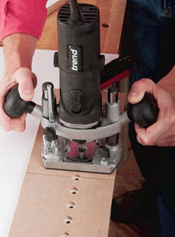 using trim router to drill holes