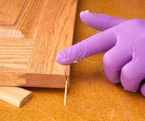 Applying paste wax to crack in wood end