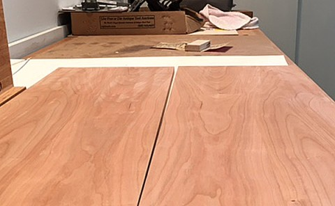 Discolored marks in cherry wood from sanding