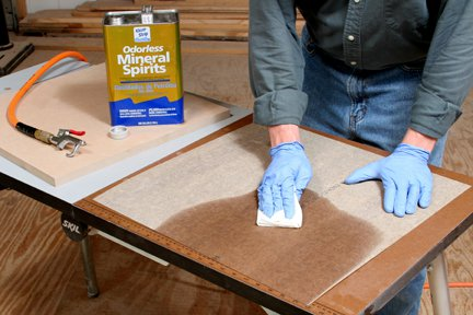 Cleaning laminate sheet backing with mineral spirits
