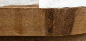 Burn mark on the edge of a piece of wood from a saw cut