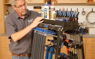 man standing next to mobile clamp rack