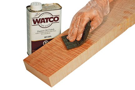 wiping Danish oil onto a board