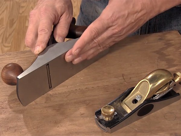 showing the sole of a hand plane